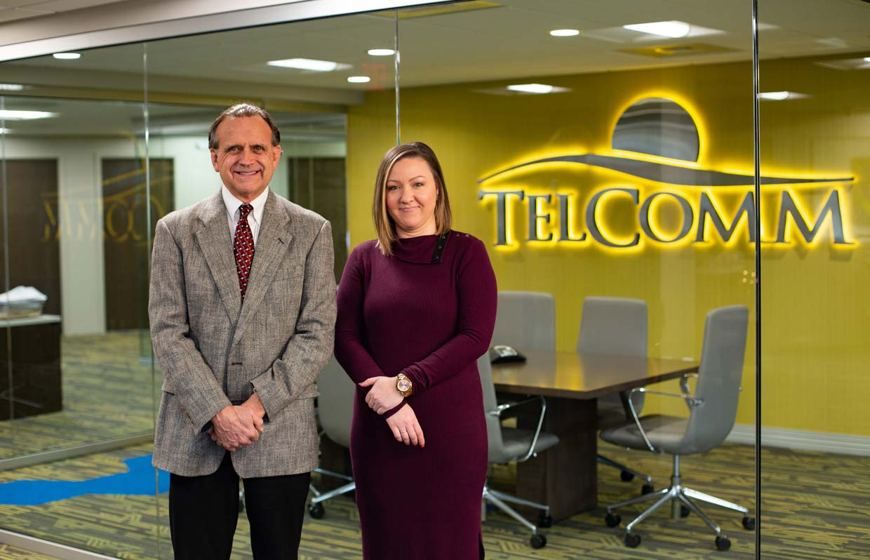 New CEO, Jessica Shorney, standing next to previous CEO, Don Ackerman.